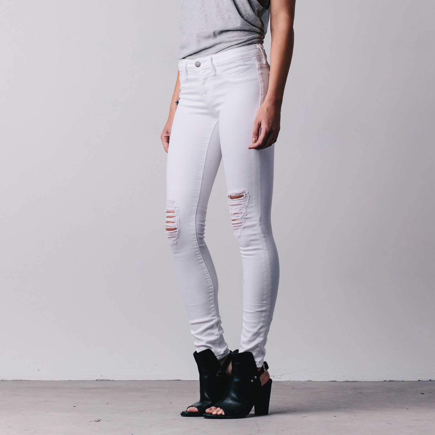 Womens Ripped Mid Rise Skinny Jeans In White | DSTLD Premium Denim