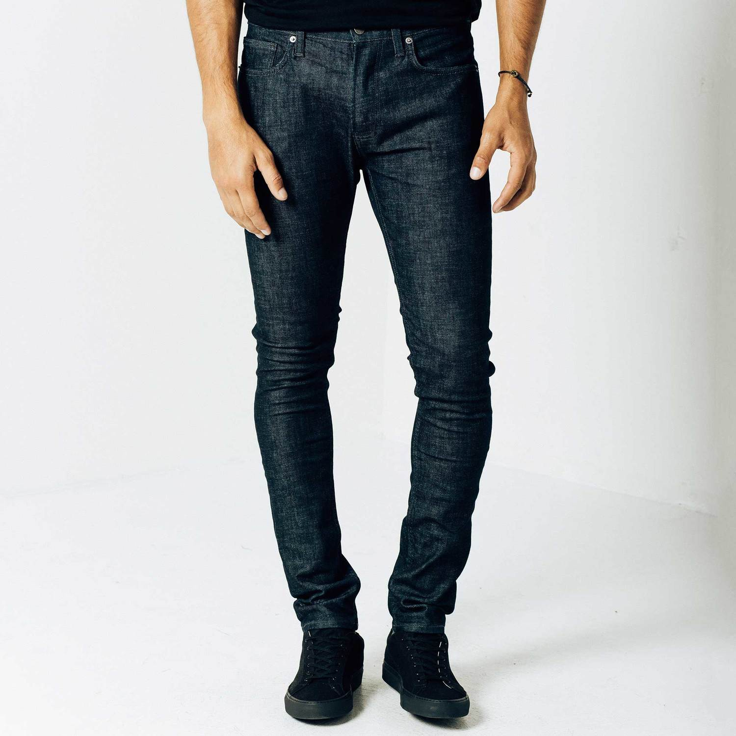 Dark Wash Jeans. Discover the dramatic look of dark wash jeans. Both men and women can enjoy wearing dark jeans with all of their favorite fashions. Denim is superbly versatile and can be worn with all kinds of textures and colors, from snake skin to cotton.