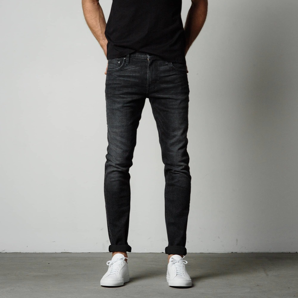 Wash, worn, faded: our men's black skinny jeans are inspired by the blasé street style attitude found in New York and London. Close fitting through the thigh and tapered throughout, we've forged this pant with a highly comfortable slub modal cotton blend that provides ample stretch and recovery for the most comfortable wear/5(39).